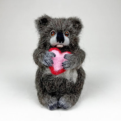 fuzzy felted brown Koala bear holding red and pink heart