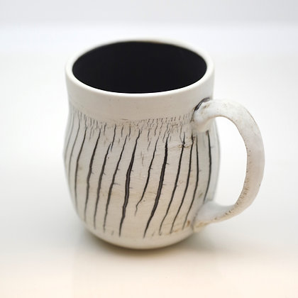 right hand view, textural white, rustic brown slash markings mug