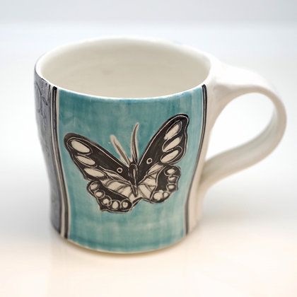 right hand view, turquoise and black butterfly mug