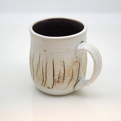 right hand view, small white mug with brown slashes in glaze