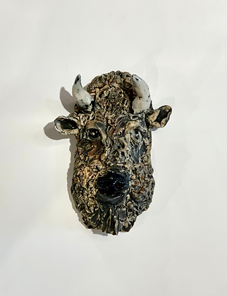 Brown and black buffalo portrait in clay