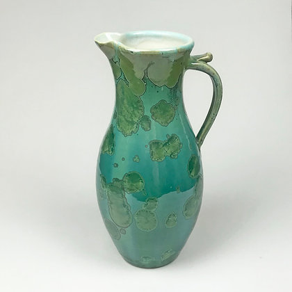 Teal and green crystalized coloring on this pitcher by Dan Ishler.