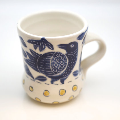 right hand view, blue raven, yellow polka dot, white mug