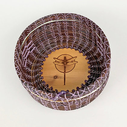 Round purple woven basket with light stitching, dragonfly image wood burned base