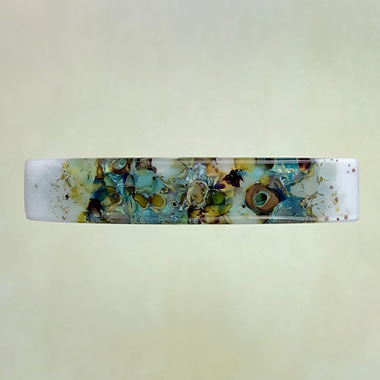 Teal and amber glass frit, fused glass barrette, on white