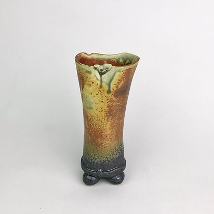 Footed clay bud vase with brown, gray, green glazes