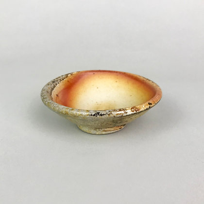 small wood fired bowl with rust and tan patterns