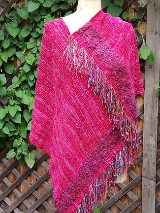 Bright deep pink handwoven garment with fringe