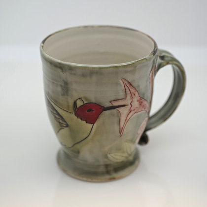 front view, red-headed hummingbird and pink flower, green mug