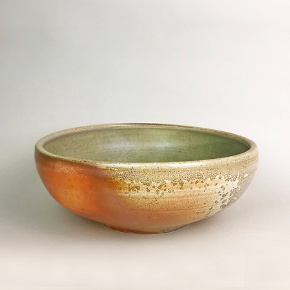 Orange and mottled gray surface on large wood fired clay bowl