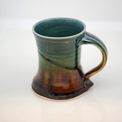 right hand view, green and brown coffee mug