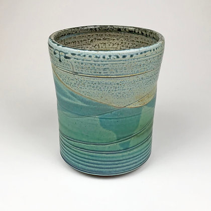 Blues and greens adorn this utensile holder by Donna and Jeff Tousley.
