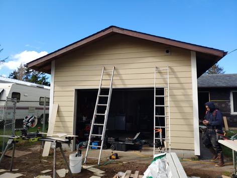 Composite corner trim with cement lap siding.