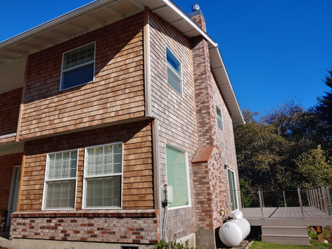 Cement siding was replaced with #1 Cedar shingles.