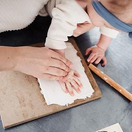 baby feet in pottery.jpg