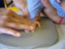 baby feet in clay.jpg