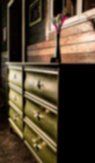 Boxwood dresser, peacock feather
