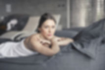 woman-covered-in-towel-lying-on-bed-3673