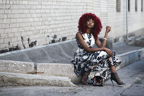 red-haired-woman-in-white-and-black-flor