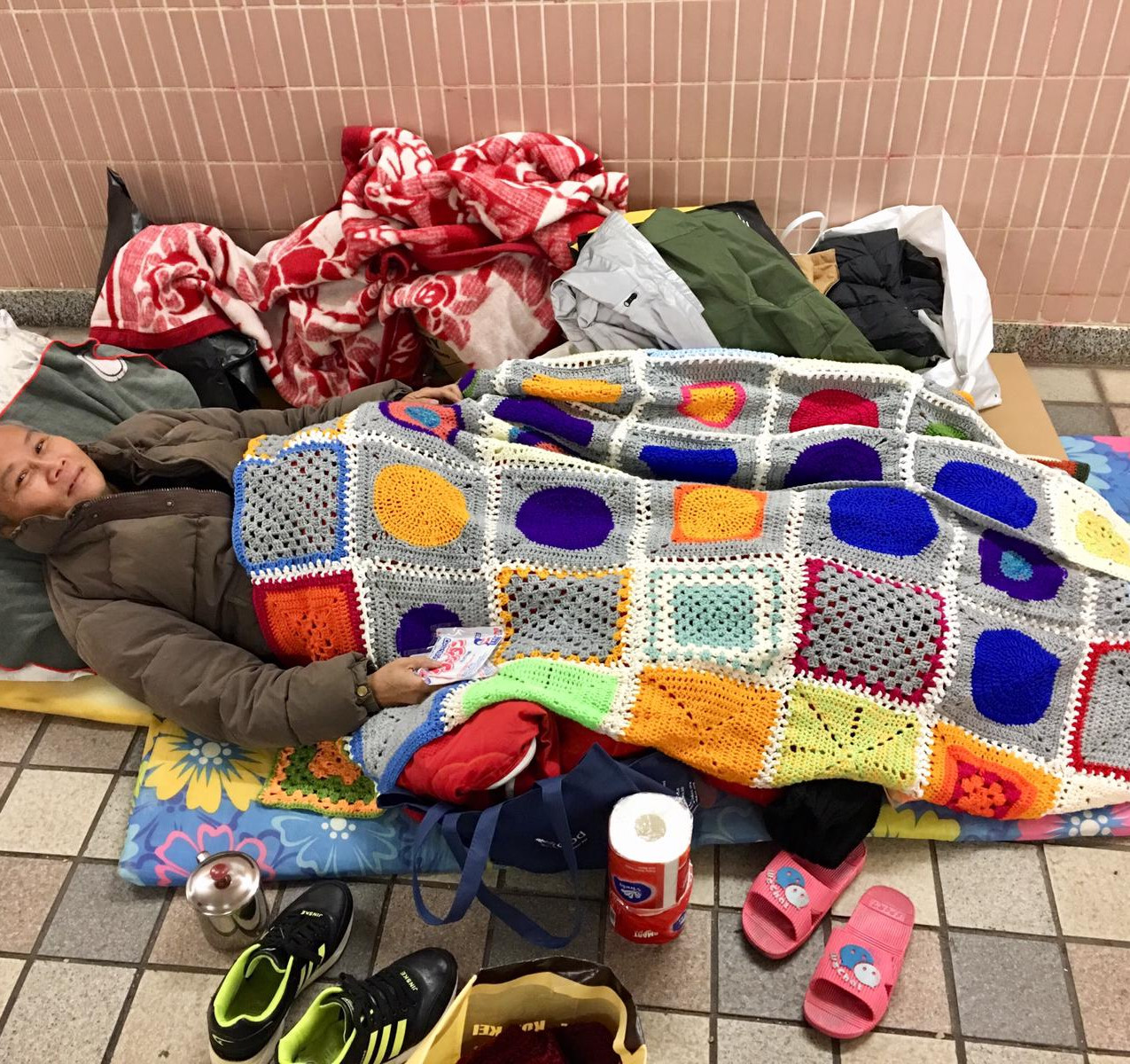 Homeless man with Completed Blanket