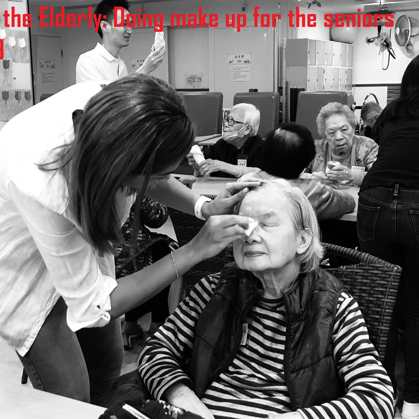 Visiting the elderly Home_Doing make up.