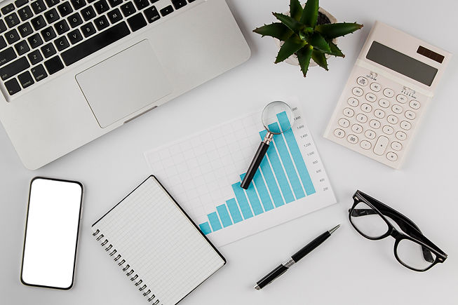 top-view-office-desk-with-growth-chart.j
