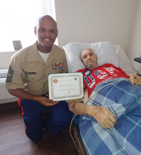 Marine gives certificate to Veteran