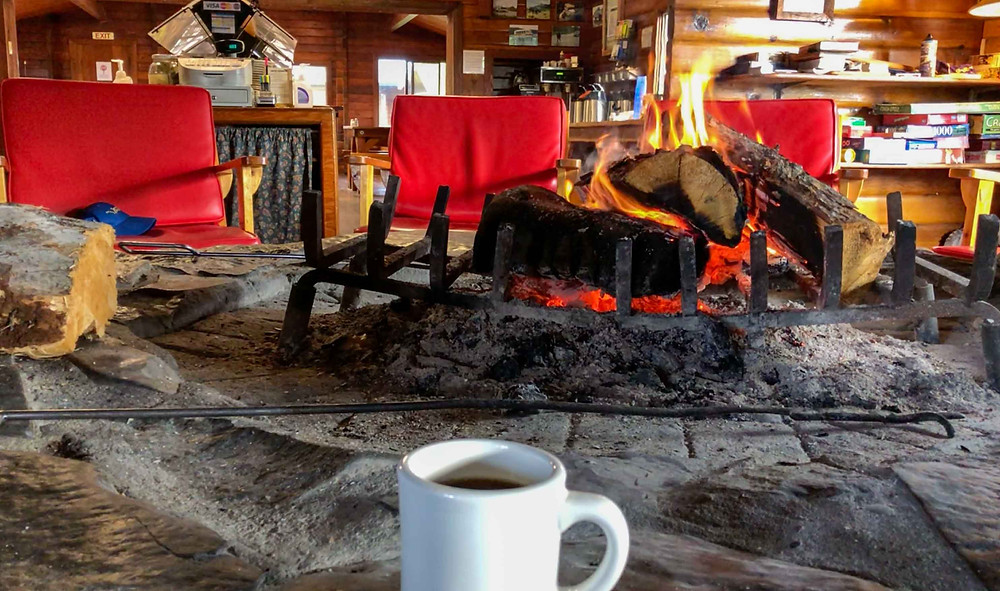 Brooks Camp lodge in Katmai National Park and Preserve with a fire and coffee.