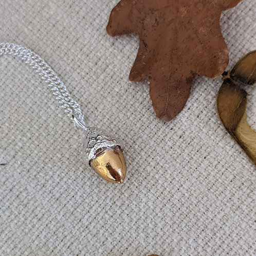 Small silver and gold acorn