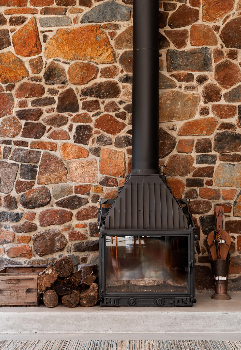 Nyaania Creek Darlington Residence - Freestanding Fireplace with site sourced granite stone wall