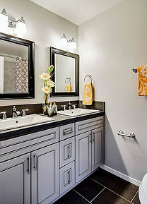 Detail of custom bathroom cabinet installs by Clark Cabinets