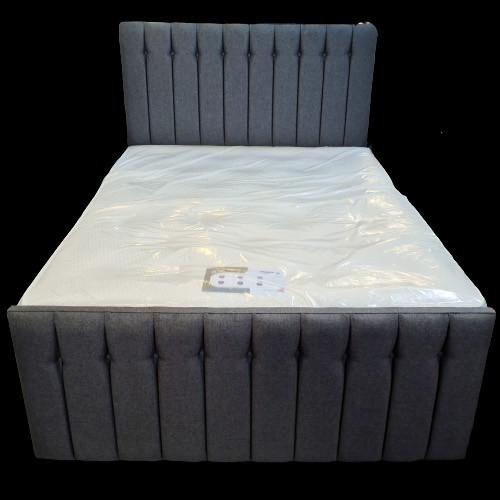 divan bed with high headboard and a mattress