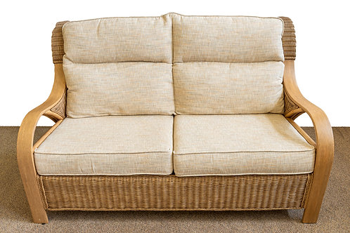 Cane sofa with beige fabric cushions