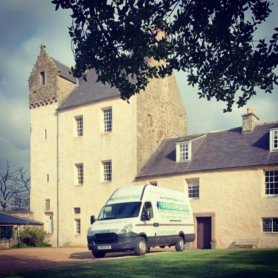 removal van in front of a castle