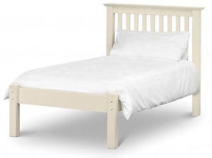 white wooden bed frame with mattress on top