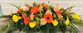 casket-spray-yellow-oranges-by-flowerlov