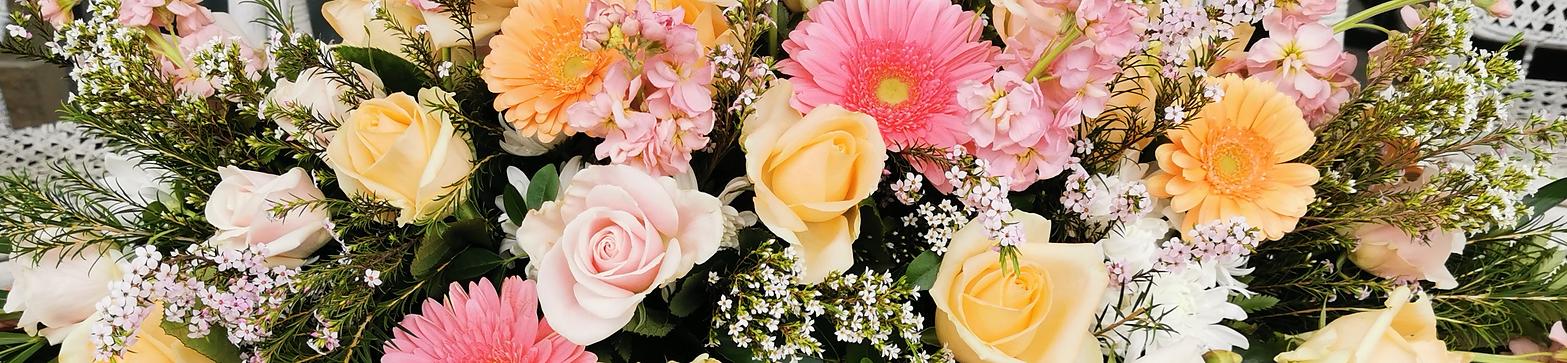 pastel-pallete-casket-spray-by-flowerlov