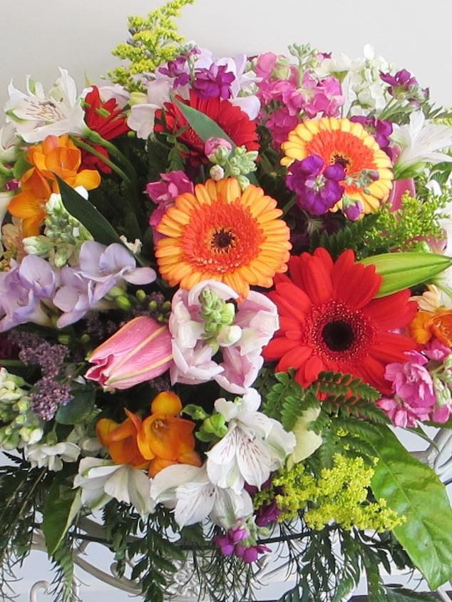 flowerlove-memorial-arrangemnt-brights.j