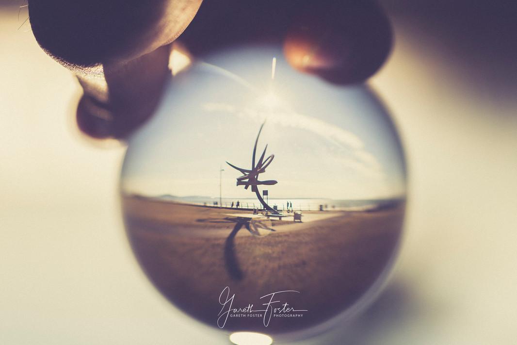 aberavon statue through a lensball