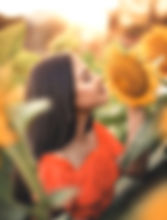 woman-smelling-sunflower-original.jpg
