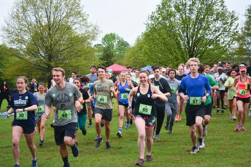 Runners cross the start line