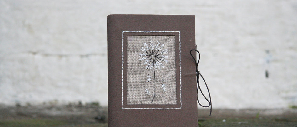 Journal with dandelion