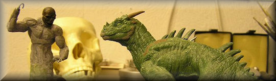miniature sculptures - a dragon and Geryon