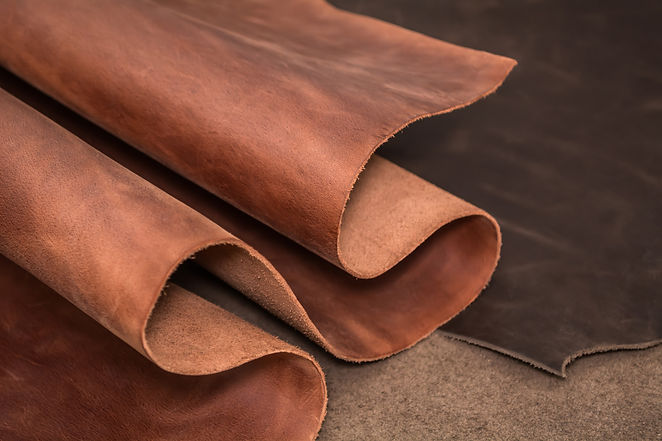 Rolls of natural brown and black leather