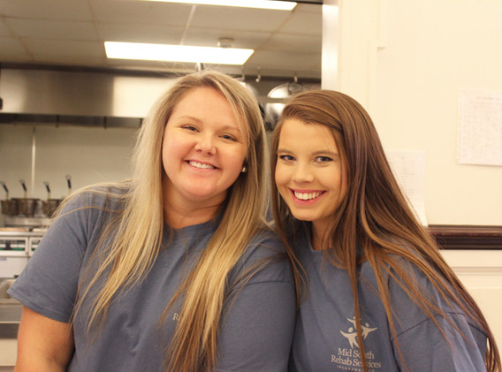 Amy Klaas and Kayla McInnis, HR clerks, serving at Stew Pot in Jackson, MS.