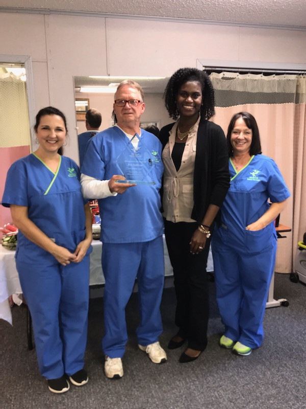 South MS Regional Clinical Director, Karen Leflore, OTR/L, awards Rex Sullivan, PTA, Employee of the Quarter.