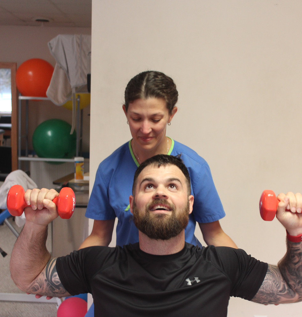 Director of Rehab and physical therapist, Shannon Rouse, assiting a patient at 360 Total Rehab in Erin, TN.