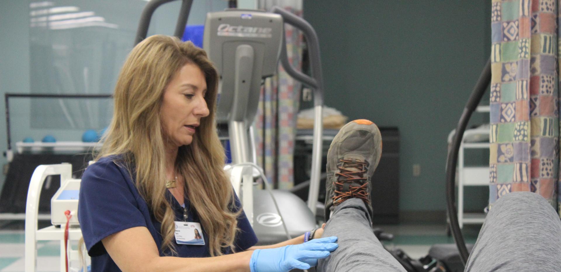 Deborah Tartt, PT, assisting a patient at UMMC-Grenada in Grenada, MS.