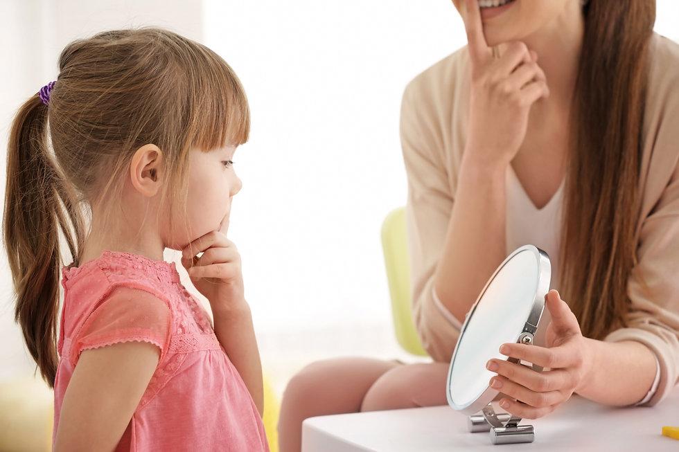 SLP Helping Little Girl Patient.jpg