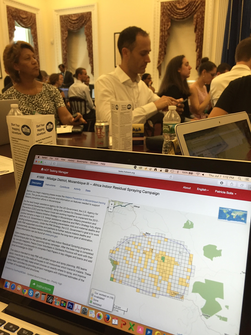 HOT Tasking Manger of the White House Mapathon mapping task. HOTOSM Executive Director, Tyler Redford watches in the background.